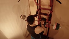Man Transforms the Wall Bars in a Home Gym Stock Footage