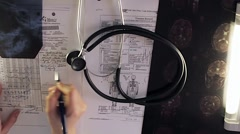 Female doctor hands writing medical diagnos - stock footage