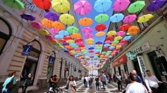 Hundreds of umbrellas hanging over the streets Stock Footage