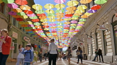 Timelapse at one street decorated with colored umbrellas Stock Footage