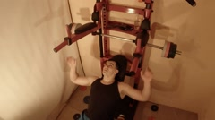 Man Doing a Bench Press With a Barbell on Swedish Wall in the Room Stock Footage