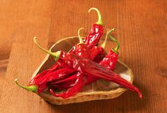 Dried Red Chili Peppers in wooden bowl - stock photo