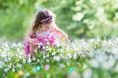 Little girl on Easter egg hunt Stock Photos