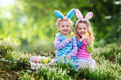 Children on Easter egg hunt Stock Photos