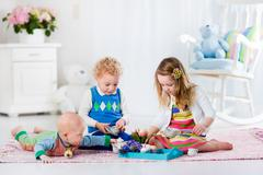 Children playing toy tea party - stock photo