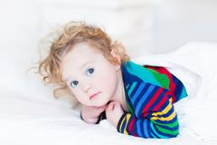 Portrait of a cute toddler girl just woke up early in the morning - stock photo