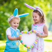Kids having fun on Easter egg hunt Stock Photos