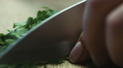 Cutting parsley with a knife closeup Stock Footage