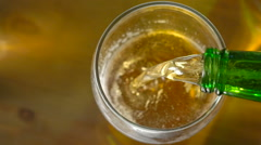 Beer being poured into glass. Slow motion . - stock footage