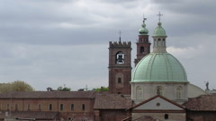 Sun on Cathedral and Bramante tower from rooftops, Vigevano, PV, Italy Stock Footage