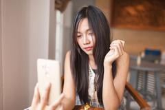 Women using smartphone for capture selfie . Stock Photos
