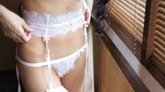 Beautiful sexy lady in elegant white panties and bra posing. - stock footage