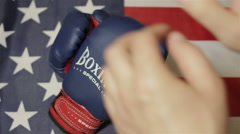 Man takes boxing gloves - stock footage