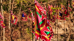 Line of Red Religious Buddha Banners Flap in Wind - stock footage