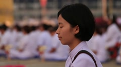 Thai girl in Buddhist ceremony, Wat Phra Dhammakaya Stock Footage