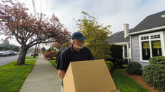 Senior delivery man in a hurry Stock Footage