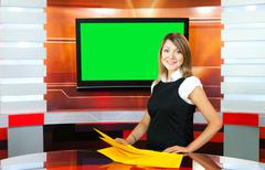 pregnant tv anchorwoman at tv studio - stock photo