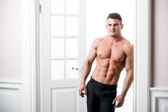 Portrait of a well built shirtless muscular male model looking straight to the - stock photo