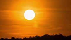 Close-up time-lapse powerful zoom lens large moving bright vivid colored sun Stock Footage