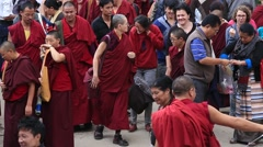Tibetan monks and people from lessons Dalai Lama, Dharamsala. India - stock footage