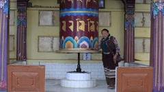 Tibetan people turning the prayer wheels at temple in Dharamsala, India Stock Footage