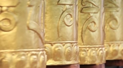 Buddhist prayer wheels in monastery with written mantra. India, Ladakh - stock footage