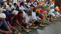 Stock Video Footage of Poor indian people eating free food in Sikh Golden Temple, Amritsar. India