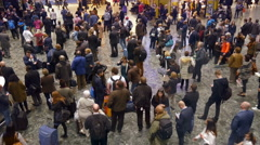 Crowd of travelers waiting on the concourse of Euston  Station. Stock Footage