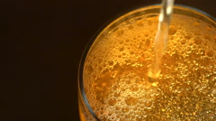 glass of beer with bubbles on dark backround - stock footage
