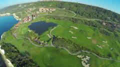 Aerial, Flight over modern golf resort close to sea coast Stock Footage