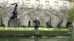 A fountain with a sculpture in the middle in the senate's park. Arkistovideo