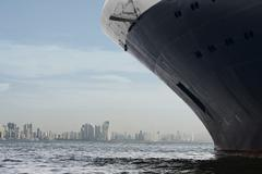 Panama city skyline. Large cruise ship entering panama city. - stock photo