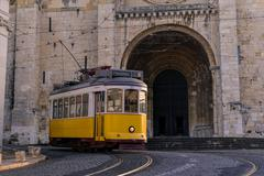 Old Lisbon traditional yellow tram Stock Photos