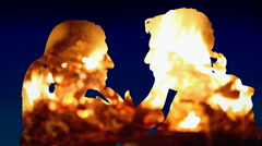 Silhouettes love story man woman night fire Stock Footage