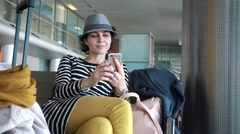 Passenger traveler woman in airport using tablet smart phone. - stock footage