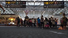 passengers arrive at check-in boarding at Suvarnabhumi Airport - stock footage