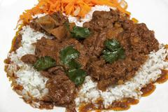 Jasmine Rice with Mutton Curry and Carrot Salad - stock photo