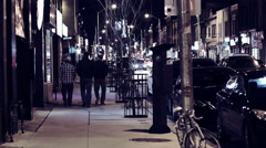 Busy street corner at night. 4K Broadcast Quality Stock Footage