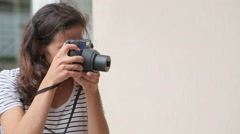 Girl makes the photo on the old-school camera and smiling - stock footage