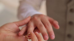 Bride wears on the groom's finger a wedding wear close up Stock Footage