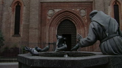 Pigeons flying away from Saint Francis of Assisi statue, Vigevano, PV, Italy Stock Footage