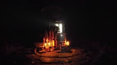 Candles shed light on sacred altar within ancient, sculpted, stone walls Stock Footage