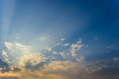 sun rays are striking through the clouds - stock photo