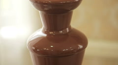 Chocolate fountain placed on a table Stock Footage