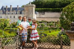Beautiful family of four in front of Villandry castle, in the gardens Stock Photos