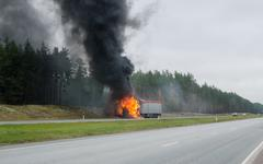 The burning truck on the road Stock Photos