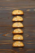 Italian cantuccini cookie with almond filling on wooden background Stock Photos