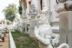 Statue of Mythical female bird with a human head at Wat Rong Khun,Thailand. Stock Photos