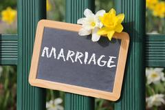 Marriage invitation card marry wedding garden with flowers flower sign board Stock Photos