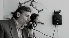 Old telephone from 1970 man answering Stock Footage